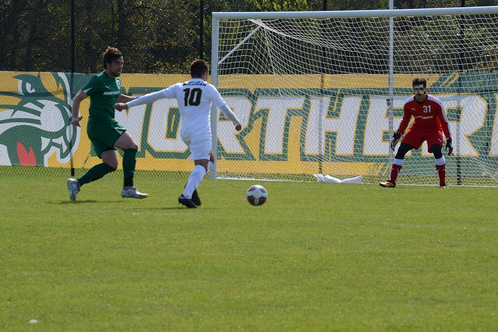 Photo+by+Lindsey+Eaton%3A+Junior+Forward+Sam+Popp+breaks+past+Marygrove+College+defender+for+a+shot+on+net+in+Septembers+match.+