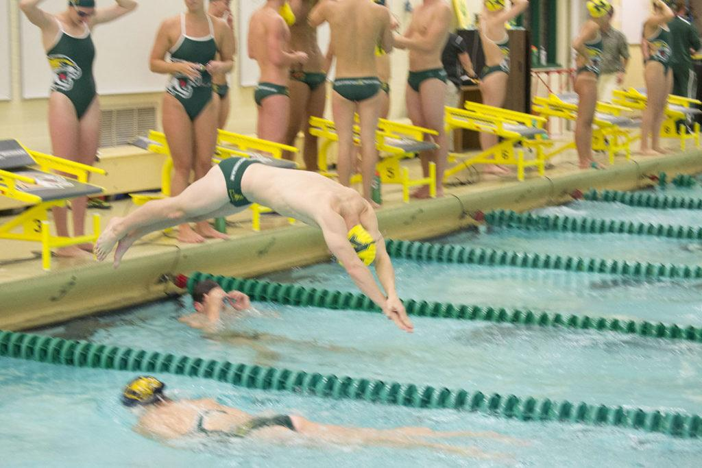 Photo+by+Lindsey+Eaton%3A+Junior+Marquette+native+Nathan+Rotundo+dives+into+the+pool+after+the+scrimmage+for+a+200-yard+cool+down.+