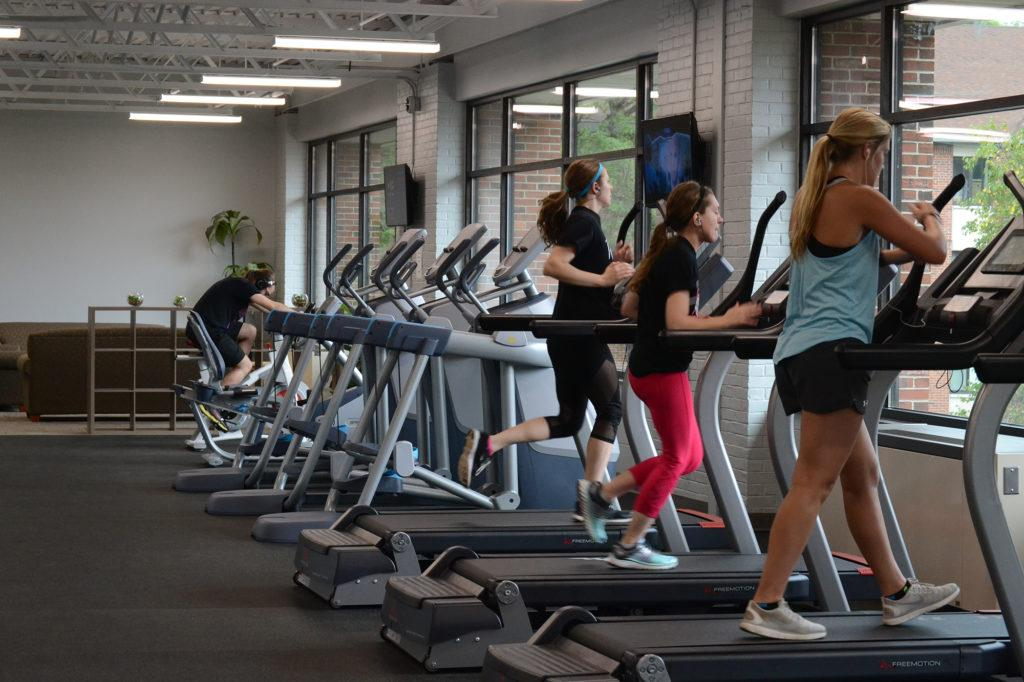 Photo+by+Lindsey+Eaton%3A+Students+use+newly+acquired+cardio+exercise+equipment+at+the+Wildcat+Fit+Zone%2C+an+extension+of+the+PEIF+into+the+housing+and+residence+life+part+of+campus.+The+Fit+Zone+will+host+a+grand+opening+at+the+end+of+October.+