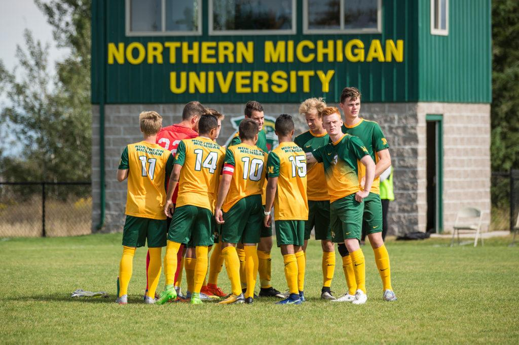 Photo+courtesy+of+NMU+athletics%3A+The+Men%E2%80%99s+Wildcat+Soccer+team+huddles+up%2C+and+puts+their+hands+in+at+a+home+game+earlier+in+the+season.+The+team+has+accumulated+a+conference+record+of+1-5+after+last+weekend%E2%80%99s+home+games.
