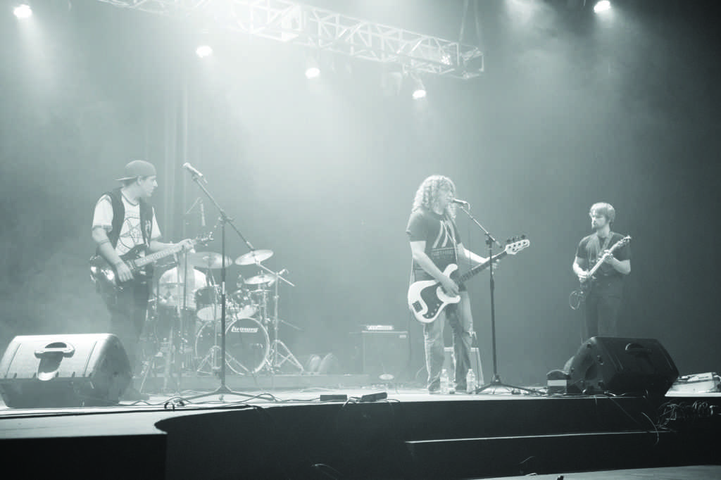 """Photo by Neil Flavin: Local heavy metal group Now Society Fails jams on stage at the """"Rock the FRT"""" battle of the bands concert Saturday night in the Forest Roberts Theatre, beating out five other music groups for the $300 grand prize."""