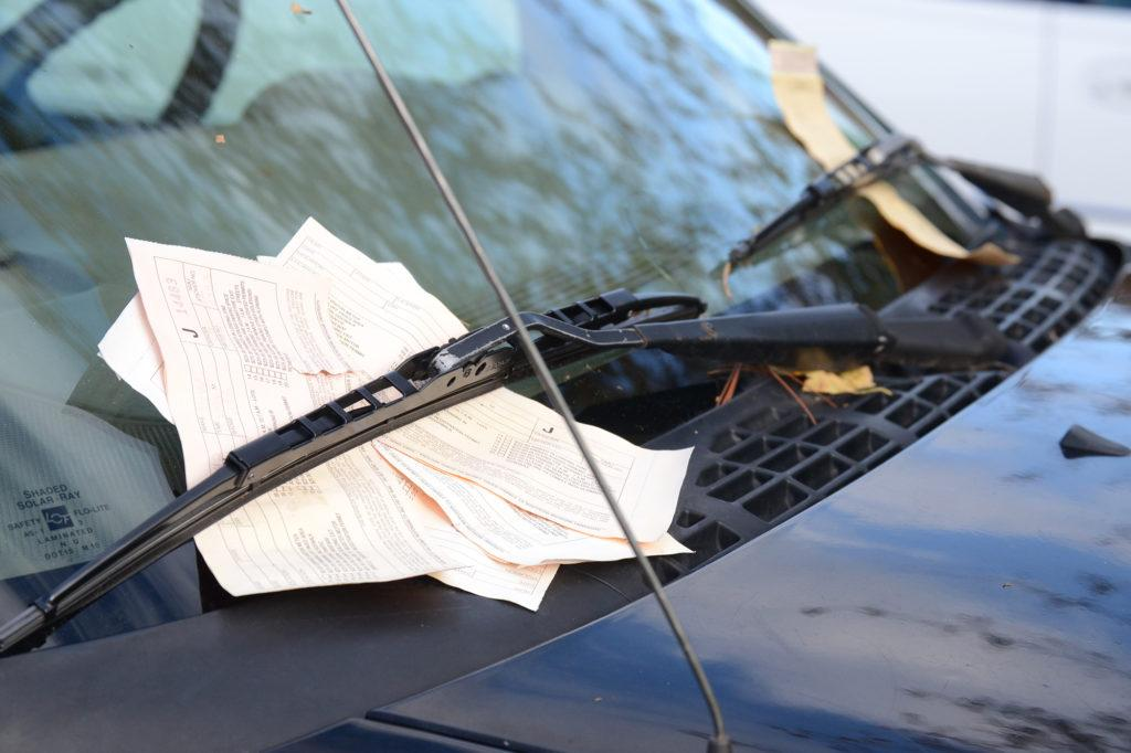 Photo by Lindsey Eaton: A student parked outside of their assigned parking lot has been given multiple tickets for the violation. These are several of 4,676 tickets that have been issued this academic year.