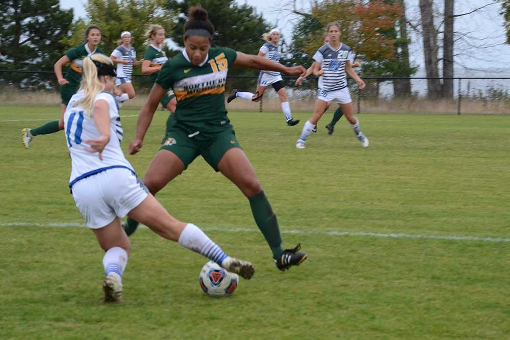 Photo by Lindsey Eaton: Junior defender Raven Mitchell steps up and makes a tackle on a Grand Valley Forward. Last season, Mitchell appeared in 17 games and started in 14. Mitchell had one shot on goal in the season.