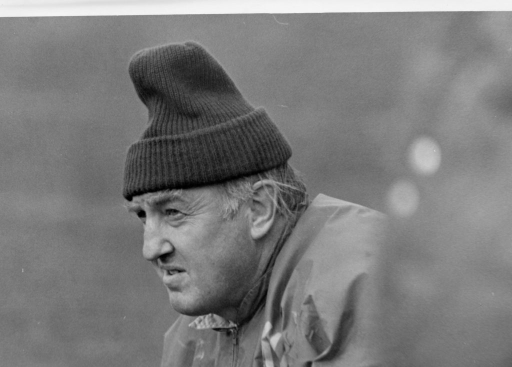 Photo courtesy of NMU archives: A younger Buck Nystrom glares out onto the field during the 1975 Wildcat football season. That year's team defeated the now Division I  teams Central Michigan and Boise State.