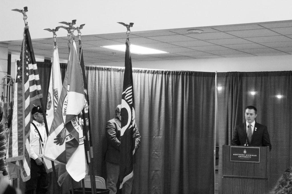Photo by Noah Hausmann: Student veteran Connor Loftus delivers the speech for NMU's Veteran's Day event.