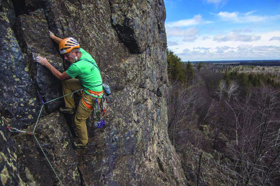 Photo by Scott Crady courtesy of Georgia Harrison: Joseph Thill climbing at the AAA wall in Marquette.