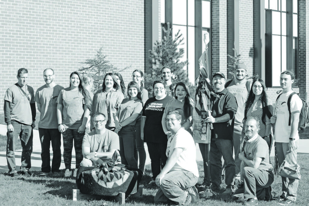 Photo+by+Lindsey+Eaton%3A+Members+of+the+NMU+Native+American+Student+Association+and+community+gather+to+show+support+of+Native+culture+during+Indigenous+People%E2%80%99s+Day+on+campus+Oct.+9.+Professor+Martin+Reinhardt+holds+the+eagle+staff.