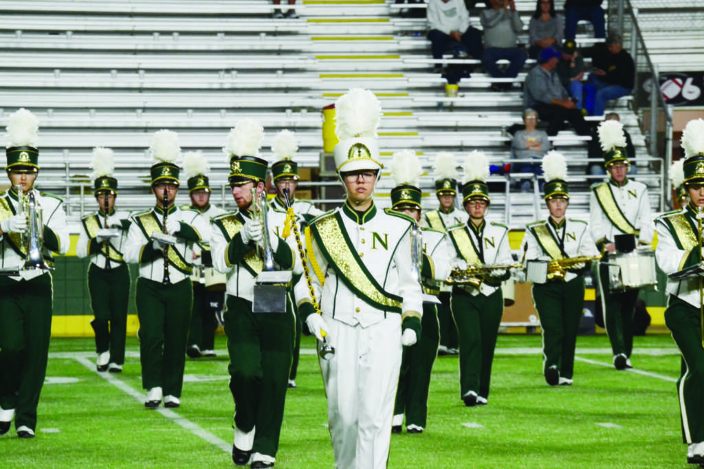 Photo by Lindsey Eaton: The Marching Band parades onto the football field at the Superior Dome during the Homecoming game this fall.