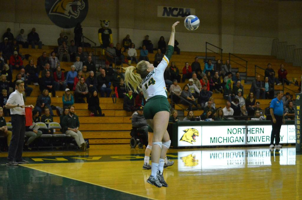 Photo by Emma Case: Senior setter Jami Hogeboom serves the ball against the Northwood Timberwolves. Hogeboom has accumulated 47 kills this season and her career total stands at 157.