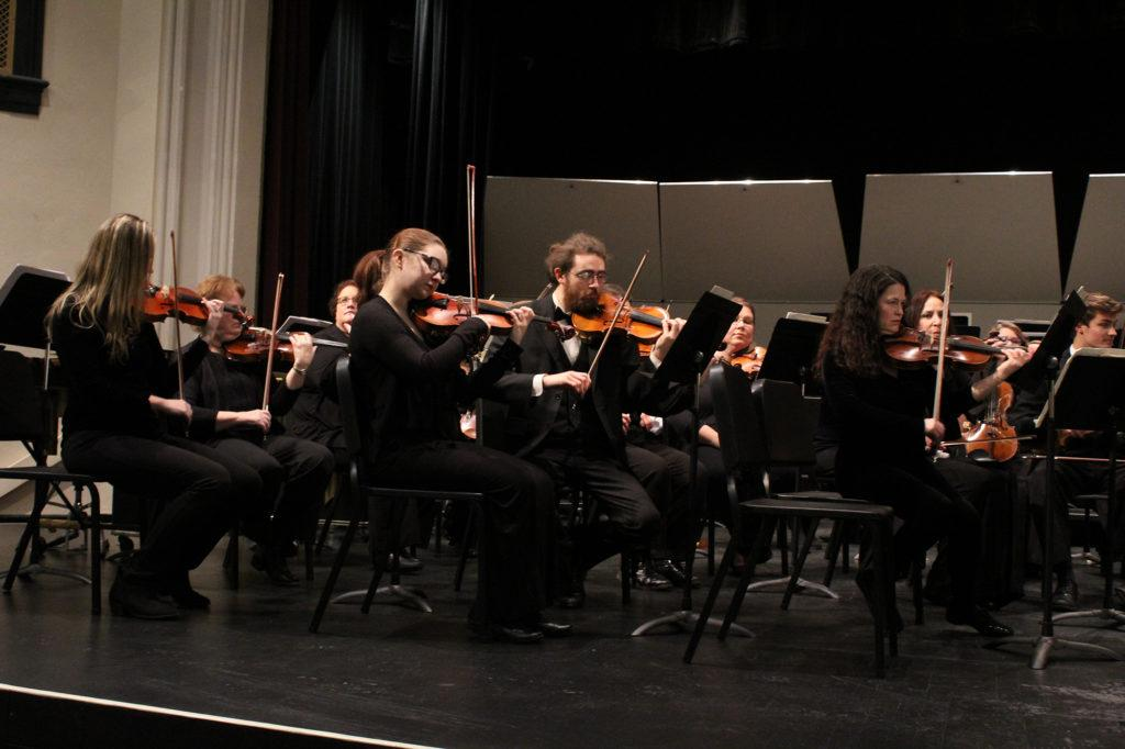 Photo by Noah Hausmann: Marquette Symphony Orchestra musicians perform on Saturday, Nov. 11 at the Kaufman Auditorium inside the historic Graveraet school on Front Street in Marquette.