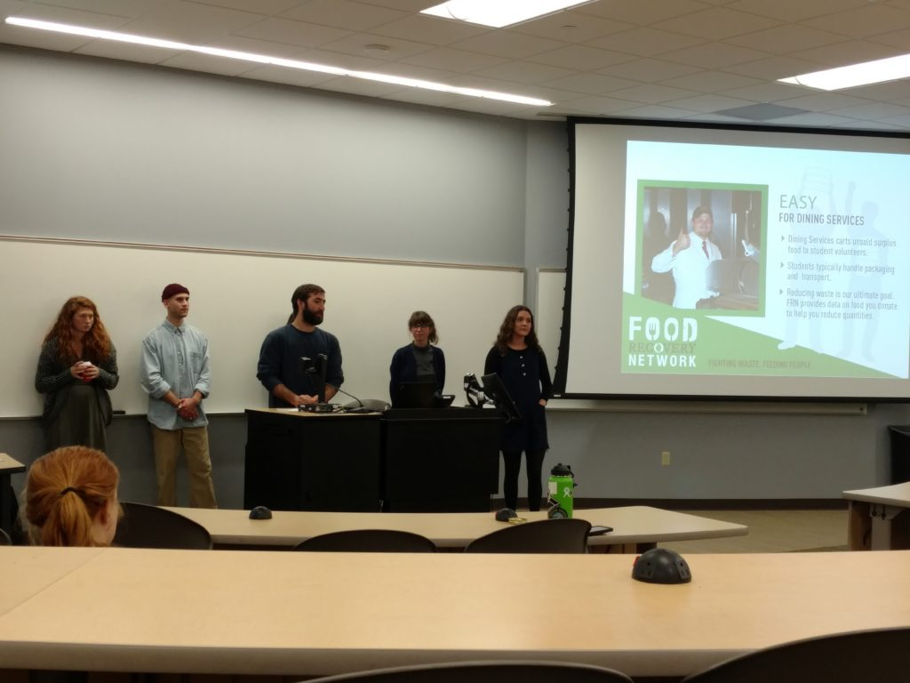 Photo by Trinity Carey: The newly formed Food Recovery Network at NMU discusses why food waste is a problem and the ways they plan to provide a solution to members of the campus community in a classroom in Jamrich Hall.