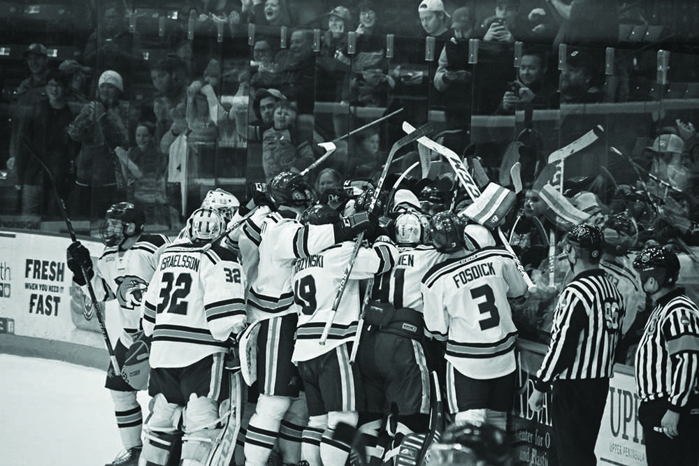 The+Wildcats+bring+it+in+for+a+team+huddle+after+taking+the+Bowling+Green+Falcons+into+overtime%2C+and+defeating+them+3-2.+The+team+now+prepares+to+take+on+Lake+Superior+State+University.%0APhoto+by%3A++Lindsey+Eaton+%2FNW