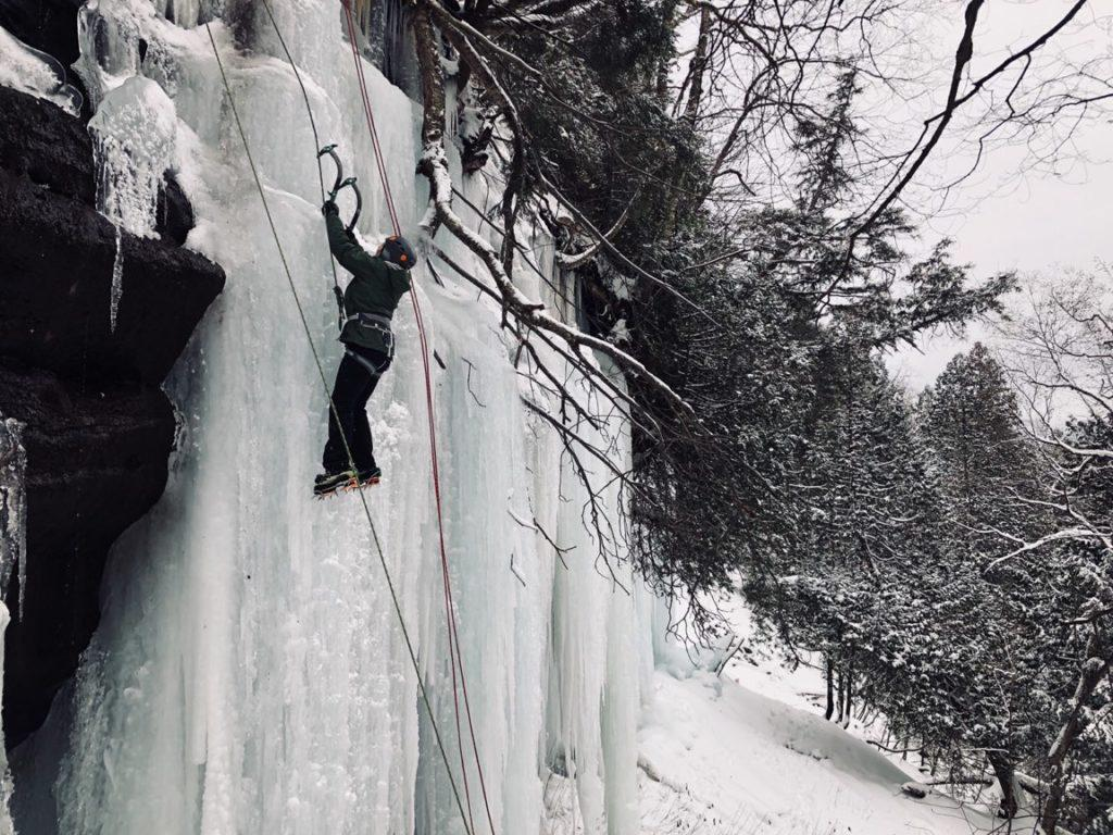 Ice climber Emily Gantner picks her way to the top while paying atteniton to technique and anticipating her next move. Photo by: Devon Hains