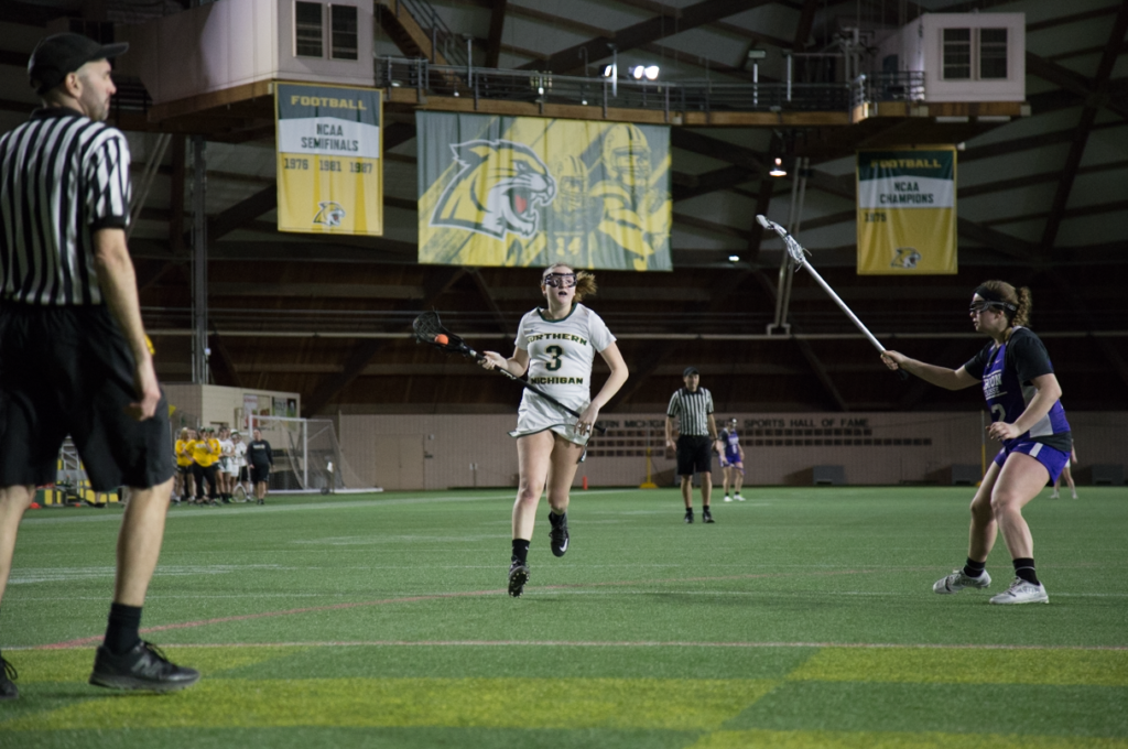 Freshman+midfielder%2Fattacker+Tess+Kostelec+%28Columbia%2C+Maryland%29+leads+the+ball+forward+in+Saturday%E2%80%99s+exhibition+loss+against+Albion+College.+Kostelec+assisted+on+a+goal+and+registered+one+shot.Photo+by%3A+Neil+Flavin