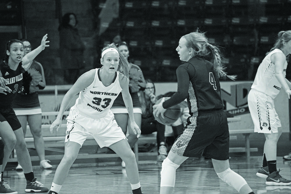 Junior+guard+Tess+Weatherly+stands+tall+against+GVSU%E2%80%99s+Jenn+Deboer.+NMU+was+able+to+stop+the+Lakers+in+the+first+half%2C+but+had+trouble+scoring+in+the+final+20+minutes.%0APhoto+by%3A+Lindsey+Eaton