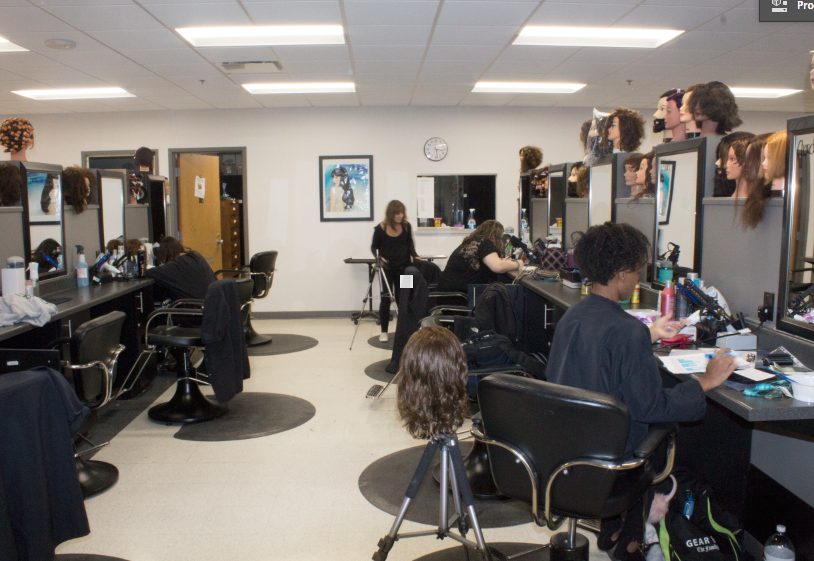 Cosmetology+students+work+at+their+styling+stations+in+the+cosmetology+salon+located+in+the+Jacobetti+Complex.%0APhoto+by%3A+Trinity+Carey