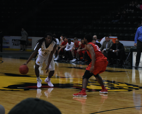 Sophomore guard Sam Taylor sets up a play from a previous home game at the Berry Events Center. Taylor is one of the players that coach Sall will rely on next year to carry the 'Cats back to the GLIAC tournament and beyond. Photo by: Lindsey Eaton