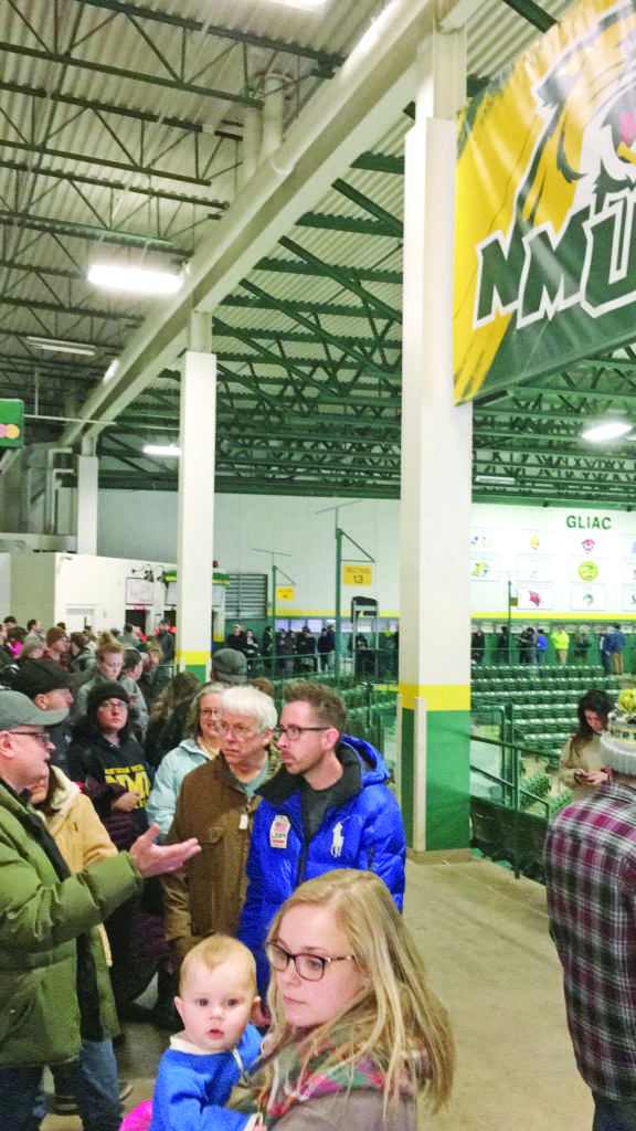 Community members stand in line on Monday, waiting to purchase tickets for the Hockey Association championship game between NMU and MTU that will take place Saturday. Tickets sold out in four hours. Photo by: Lindsey Eaton
