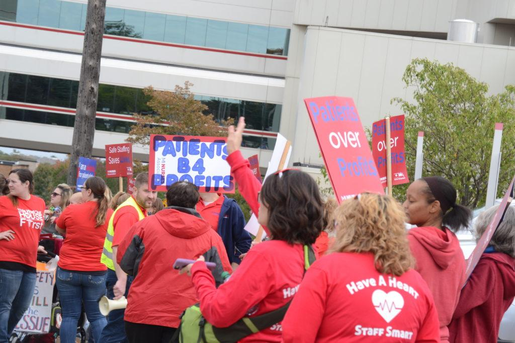 Lindsey Eaton/NW Protestors stand outside of Marquette General Hospital, participating in the strike this past October. Nurses began negotiating patient safety concerns in April of 2017 with Duke LifePoint, the new administration.  Photo by: Lindsey Eaton