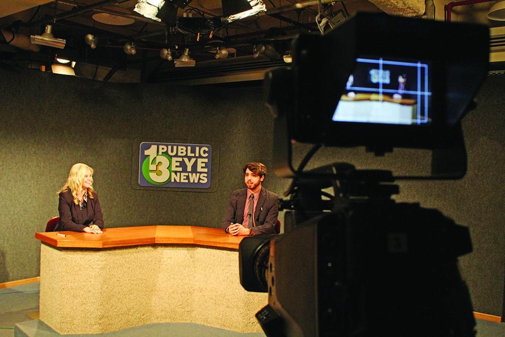 Multimedia production majors freshman Jillian Wurmlinger and co-news anchor senior Anthony Cilia host a live broadcast of Public Eye News. Photo by Noah Hausmann