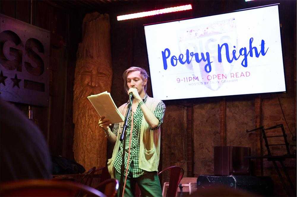 Senior English major Ezra Brooks-Planck recites his creative verse on Tuesday at Poetry Night at DIGS Gastropub, a monthly open-mic event that invites people to share their poetry with the community.