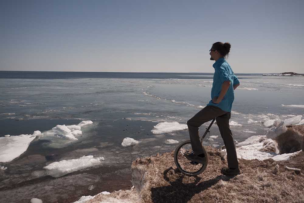 Jeremy Martin, a senior Native American studies major, mounts his first unicycle, reflecting on the hobby that has inspired and challenged him. Photo by: Isabelle Tavares