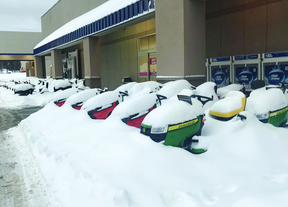Northern Michigan students had the day off from school Monday and Tuesday thanks to an April snow shower.  The unusual precipitation covered Marquette in 15.8 inches of snow. Photo by: Kat Torreano