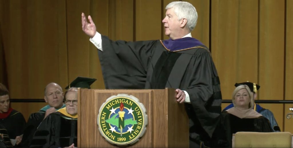 In this screenshot from a WNMU Public Television, Channel 13 broadcast, Gov. Rick Snyder speaks at the May 5 commencement ceremony inside of the Superior Dome.