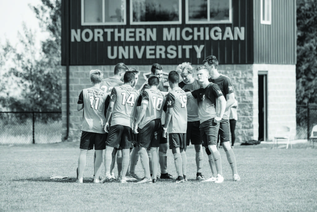 %0AMembers+of+the+NMU+Men%E2%80%99s+Soccer+Team+huddle+at+midfield.+The+team+looks+to+maintain+its+early-season+momentum+against+Quincy+University%2C+the+third+consecutive+team+the+Wildcats+will+meet+for+the+first+time.+%0APhoto+courtesy+of+NMU+athletics%2FNW