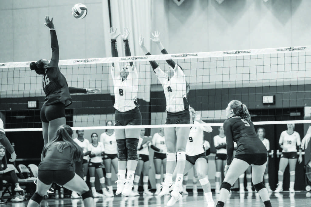 %0ASenior+outside+hitter+Maggie+Liebeck+%28left%29+and+sophomore+outside+hitter+Cierra+Martinez+%28right%29+rise+up+to+defend+a+spike+against+Michigan+Tech+University.+With+the+loss%2C+the+%E2%80%98Cats+have+now+dropped+back-to-back+games.%0APhoto+courtesy+of+NMU+athletics