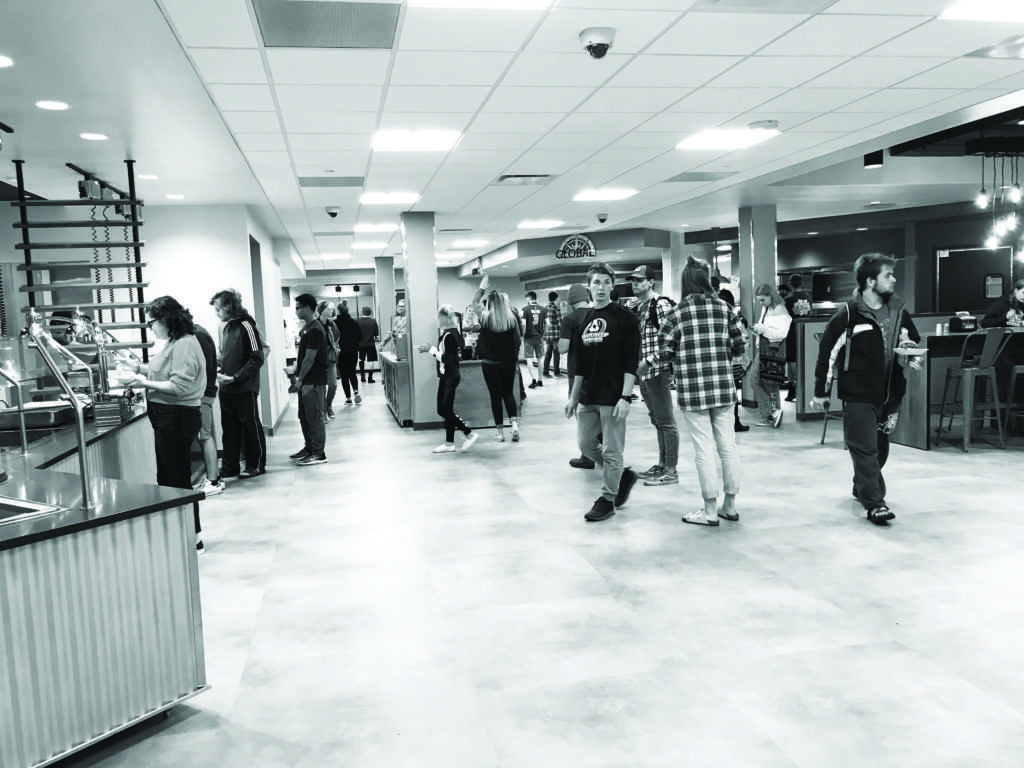 Students gather in the Northern Lights Dining facility to experience the new food, seating areas and layout. The facility has 10 micro-restaurants in total, in comparison to the previous facility's buffet style.  Photo by Kelsii Kyto