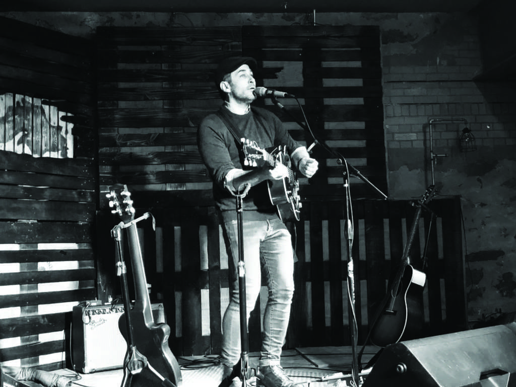 """Joshua Davis, Marquette native and 2015 third-place finalist on NBC's """"The Voice"""" attracted a full house at the Ore Dock Brewing Co. last Friday night. He played new songs from his EP """"Secondhand. Photo by: Jackie Jahfeston"""