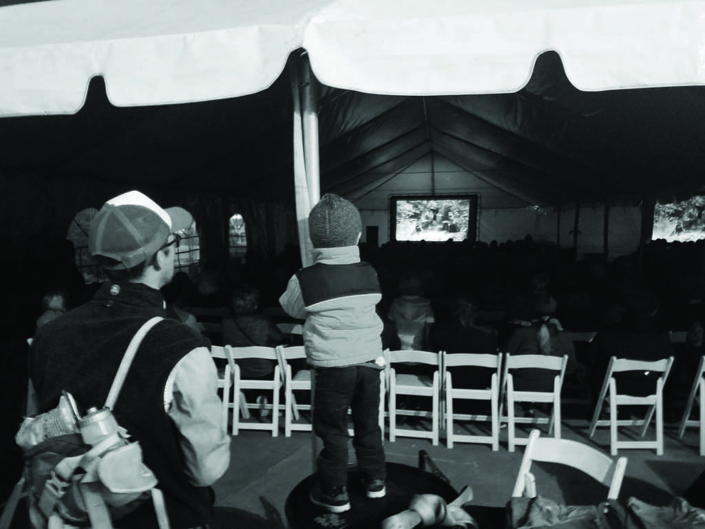 A Marquette boy watches intently as the first film of the festival begins. Photo by: Cole  Stefl