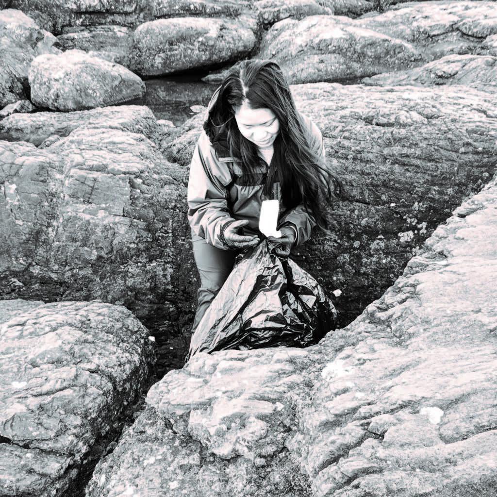 Photo+courtesy+of+Lynnae+Branham%0AJunior+environmental+studies+and+sustainability+major+Carli%0ACapacio+cleans+up+trash+on+Black+Rocks.