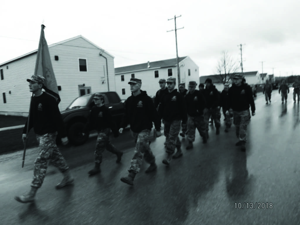 Elite cadets of Northern Michigan University's ROTC program march in line down a street in Fort McCoy during a Ranger Challenge competition, which is the ROTC's varsity sport. Photo courtesy of NMU ROTC