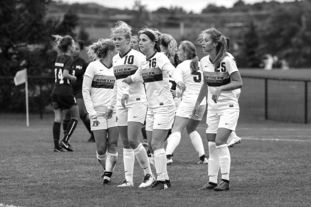 Team+senior+captain+Aimee+Colla+%28no.+16%29+stares+downfield+with+teammates+during+a+break+in+play.