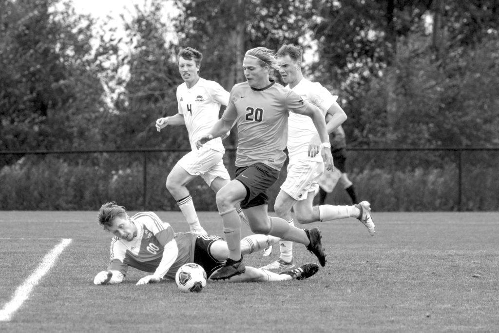 Photo courtesy of NMU athletics NMU redshirt sophomore Ben Hoffman corrals a loose ball past a sprawling Viterbo University goalie and scored in a previous matchup this season. Hoffman continued his hot scoring streak by recording a goal against Ashland University in what proved to be the deciding goal in a 1-0 contest.