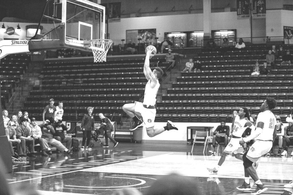 Photo+courtesy+of+NMU+athletics.+%0ASenior+guard%2Fforward+Isaiah+Johnson+rises+up+and+slams+home+a+dunk+earlier+this+season.+Johnson+is+the+two-time+defending+GLIAC+Player+of+the+Week.