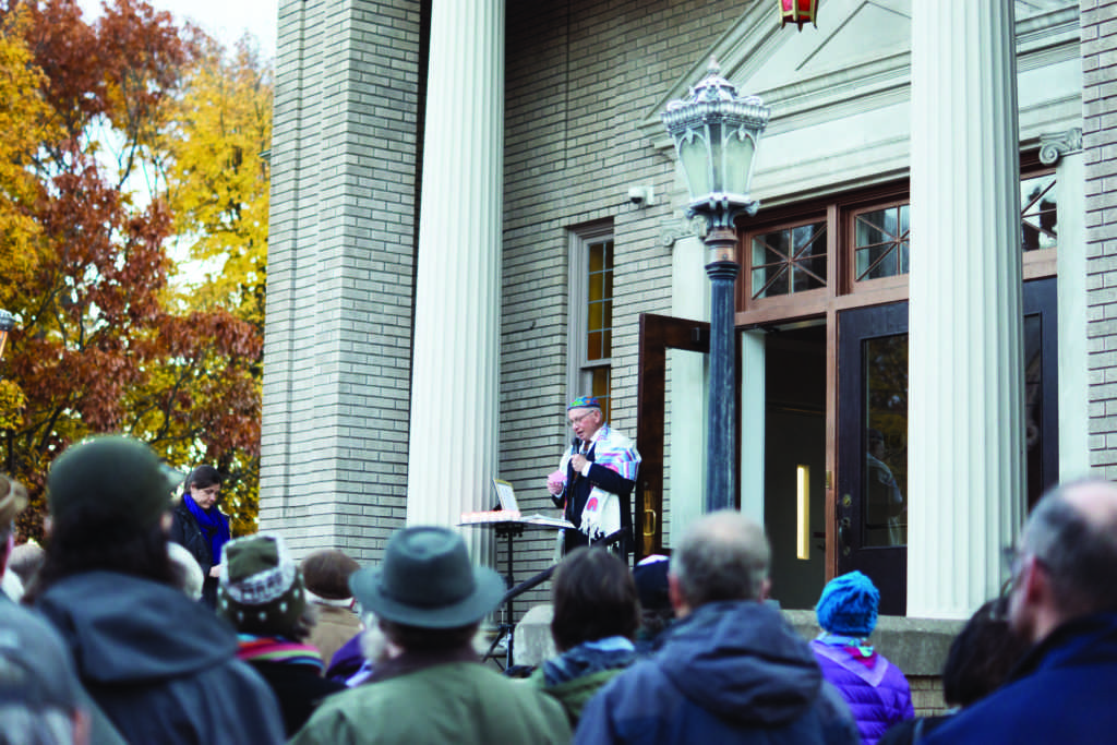 Temple+Beth+Sholom+board+member+Aaron+Scholnik+addresses+community+members+who+gathered+Monday+for+a+candlelight+vigil.++The+vigil+was+held+to+honor+the+11+lives+lost+in+a+mass+shooting+which+took+place+Saturday+at+Tree+of+Life+Synagogue+in+Pittsburgh.+%0APhoto+by%3A+Kat+Torreano