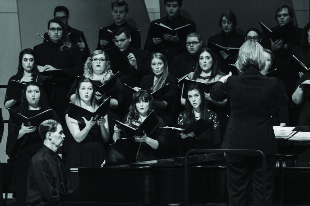 Members of the NMU University Choir and Arts Chorale sing during the inaugural  Veterans Day concert.  Photo by Jacob Darner