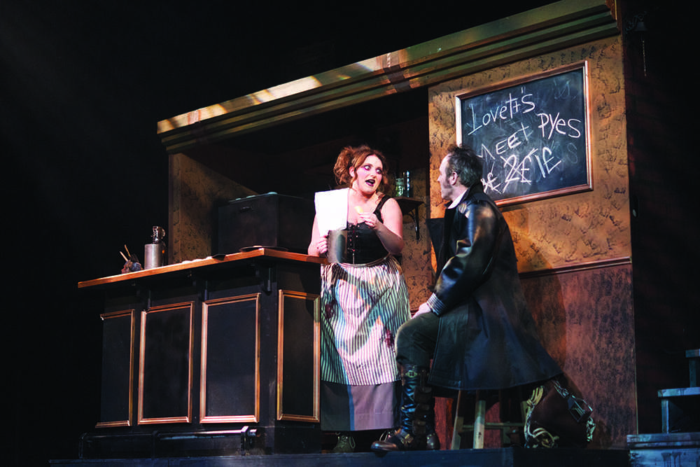 Below%3A+A.J.+Stephens%2C+junior+musical+theater+and+business+major%2C+as+Mrs.+Lovett+and+Paul+Truckey%2C+theater+professor%2C+as+Sweeney+Todd+conspire+to+make+meat+pies.%0APhoto+by+Kat+Torreano