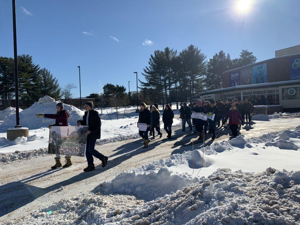 Students march outside of Forest Roberts Theater on Martin Luther King Jr. day as part of a week of events dedicated to celebrating and honoring the work of MLK.  Photo by Kelsii Kyto