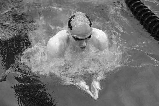 Photo+courtesy+of+NMU+Athletics.+%0AAn+NMU+swimmer+comes+up+for+air+before+continuing+his+trek+down+the+pool.+Both+the+Men%E2%80%99s+and+Women%E2%80%99s+teams+defeated+University+of+Wisconsin+Green+Bay+in+the+meet.