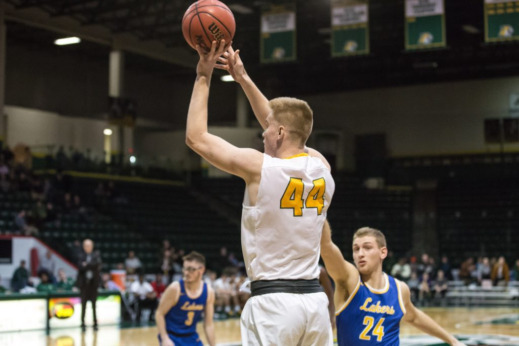 Redshirt-freshman forward/center Troy Summers rises up for a shot at against the Lake Superior State Lakers earlier this season. Summers scored 14 points and collected four rebounds in the game.  Photo courtesy of NMU Athletics