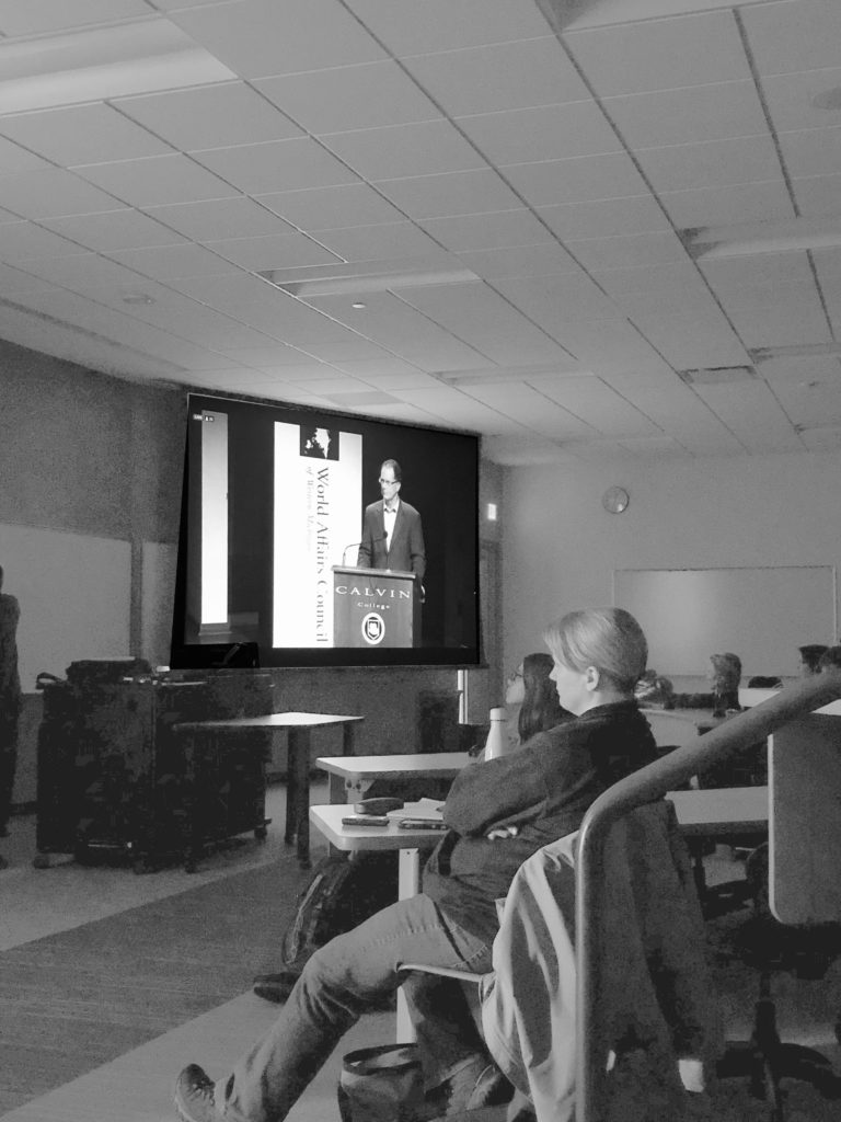 Attendees watch former U.S. Ambassador James Nealon at a virtual lecture Tuesday afternoon on a screen in Jamrich room 1320. Jackie Jahfetson/NW
