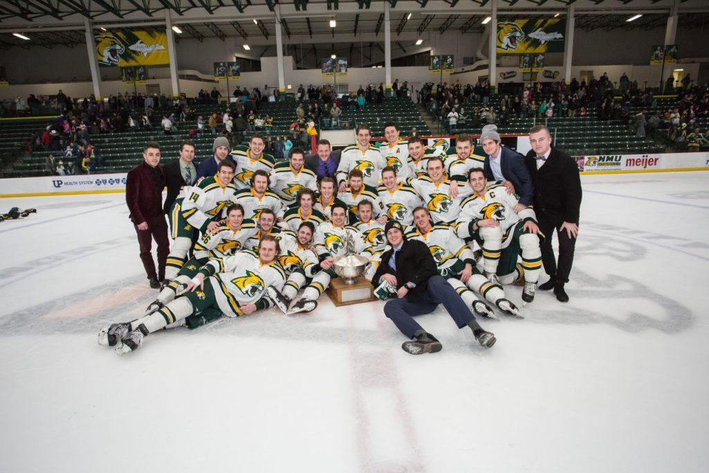 Members of the NMU Men's Ice Hockey team pose with the Cappo Cup after last weekend's sweep of the Lake Superior State University Lakers. The trophy is awarded to the season series winner between the two teams.  Photo courtesy of NMU athletics