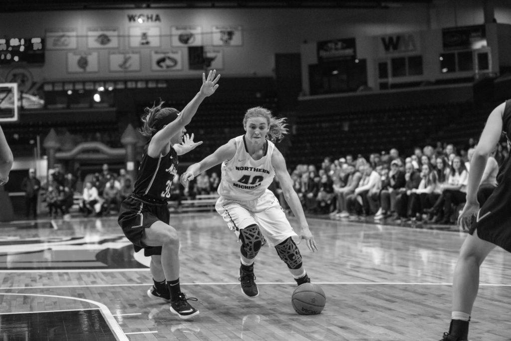 Sophomore+guard%2Fforward+Lexi+Smith+dribbles+down+the+lane+in+a+previous+home+matchup+against+Michigan+Tech+University.+Smith+has+appeared+in+each+of+the+21+games+played+this+season.%0APhoto+courtesy+of+NMU+Athletics