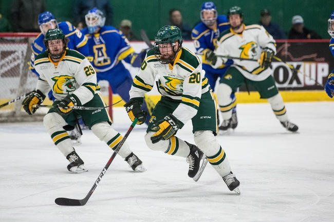 Freshmen+Wildcats+Garrett+Klee+%2820%29+and+Grant+Loven+%2829%29+look+to+jumpstart+a+play+in+the+offensive+zone+during+last+weekend%E2%80%99s+WCHA+quarterfinal+matchup+against+Alaska-Fairbanks.%0A%0APhoto+courtesy+of+NMU+athletics
