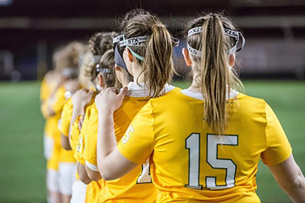 During her time at NMU, senior defenseman Tori Aidif (front) treasured many experiences with her team.  Photo courtesy of NMU athletics