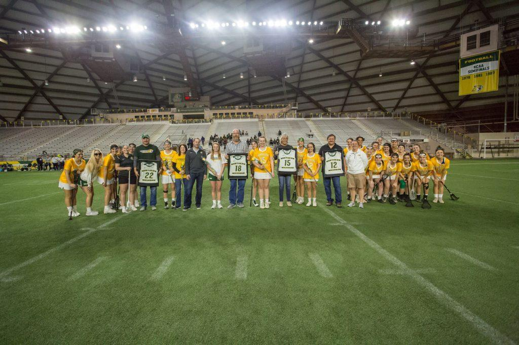 The NMU Women's Lacrosse team poses with its four seniors during its Senior Day festivities last weekend.  Photo courtesy of NMU athletics